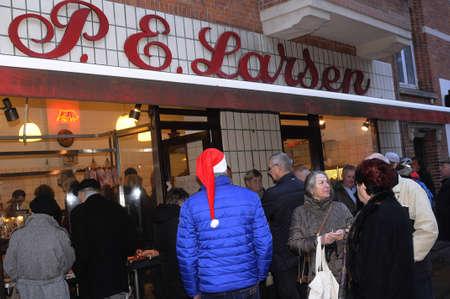 christmas shopper: Copenhagen  Denmark_  22th.December 2016 -Christmas  shopper at P.E Larsen Butcher shop.