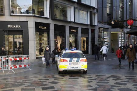 Copenhagen  Denmark_  23Th.December 2016 -dansh police blockade financial and christmas market by bricks and  Danish police (dansk politi) patrol by police cars and foot and motorbikes .