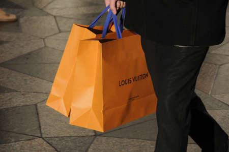 vuitton: Copenhagen  Denmark_  23Th.December 2016 -   Christmas shopper with Louis Vuitton shopping bags luxury items for christmas celebrations. Editorial