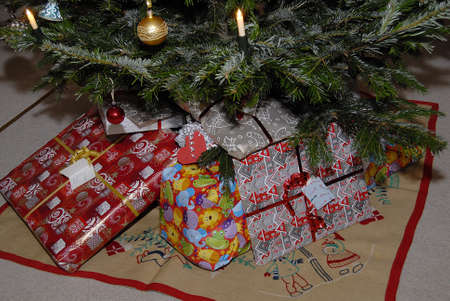 Kastrup_ Copenhagen_Denmark _ 24th December  2016_Danish christms eve christmas tree deoated and christmas presents under christmas tree . Editorial