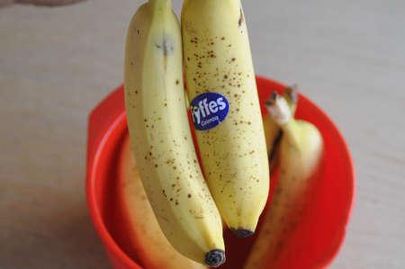 kastrup: Kastrup_ Copenhagen_Denmark _ 24th December  2016_ Bananas fruit in Plastic Bowl Editorial
