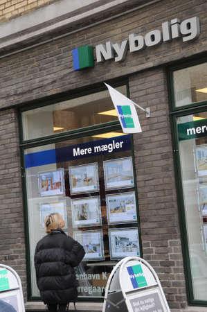 Copenhagen  Denmark_  02 March 2017 -  Woman viewing home price at real esate nybolig   in Copenhagen, Denmark. Editorial