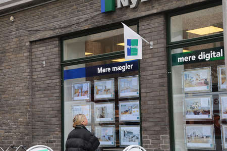 real esate: Copenhagen  Denmark_  02 March 2017 -  Woman viewing home price at real esate nybolig   in Copenhagen, Denmark. Editorial