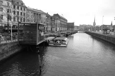 danish: Copenhagen  Denmark_  07. March 2017 -  Winter tourism in Copenhagen canal infront of danish parliament christiansborg.