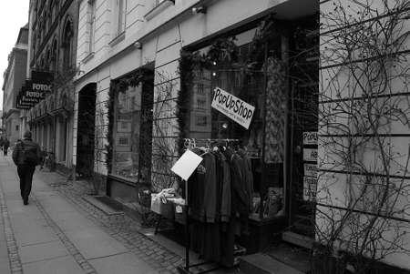 Copenhagen  Denmark_  08 March 2017 -eldlery woman searching shoe at store. Editorial