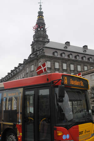 Copenhagen  Denamrk 29 March 2017 -Danish flags or dannebrog host due to respect of royal state visit of King and Queen of Belgium  in these images flags fly on all public bus transport systems and danish parliament christianborg palace .