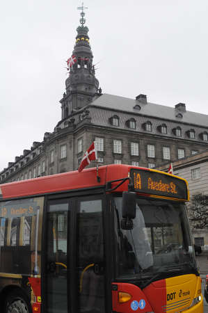royality: Copenhagen  Denamrk 29 March 2017 -Danish flags or dannebrog host due to respect of royal state visit of King and Queen of Belgium  in these images flags fly on all public bus transport systems and danish parliament christianborg palace .