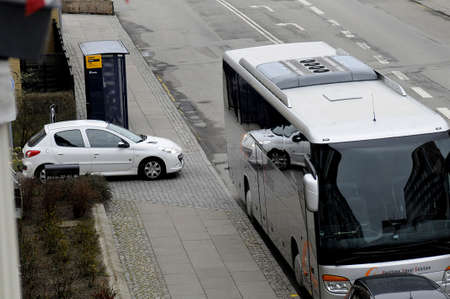 trafic stop: Kastrup_ Copenhagen_Denmark _30 .March  2017_ This tourist bus is unlawful parking first closed to Bus stop and enterance of residential, lawful is 15 fees away from bus stop and any residenial enterance area and trafic light signal.
