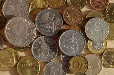 Old coins from five european countries like German Marks and austraian  currency  and Danish and swedish kroner   and british schillings