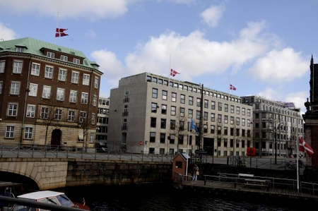 ministry: Copenhagen_Denmark _14 April 2017_  Good friday celebration and marked jesus ufering on cross danish flag at halp mast at danish parliament (folketinge)Christiansborg, danush ministries defence ,finance ,foreign ministry and national bak of Denmark and al