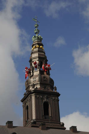 finanse: Copenhagen_Denmark _14 April 2017_  Good friday celebration and marked jesus ufering on cross danish flag at halp mast at danish parliament (folketinge)Christiansborg, danush ministries defence ,finance ,foreign ministry and national bak of Denmark and al