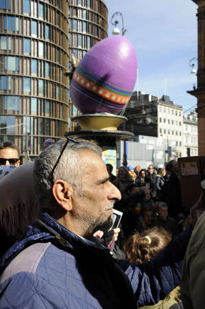 giant easter egg: Copenhagen_Denmark _16 April 2017_  Visitors waiting at Tivoli garden on easter sunday tivoli klovn  entertain visitors prior to easter opening tivoli gadren decoarted with easter eggs and tulips flowers  .