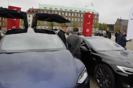 prince of denmark: Copenhagen Denmark - 24. May 2017.  Danish prince Joachim arrives in American made Tesla electric car at Trophy CopenhagenMonte Carlo electri car rally and wellcome by Andriy Billyy President of the eent Trophy Copenhagen Monte Carlo rally at Christiansb Editorial