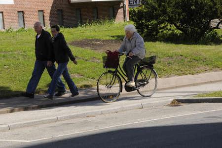 kastrupCopenhagen Denmark - 05.June  2017.     Eldlery woman rides bike