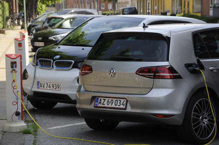 finanse: Copenhagen Denmark - 06 June 2017. Two German Electric  vehicle Volks Wagen VW and BMW at recharge E.On electric booth . Editorial