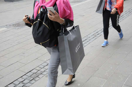 finanse: Copenhagen Denmark - 10 June 2017.  Asian consumers purchaes dish brand ecco products  and with shopping bags