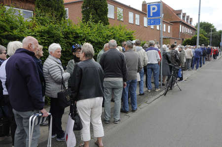 Copenhagen Denmark - 14 June 2017.  Danish senior citizen standing in line to buy annual picnic ticket from council for annual lunch party.