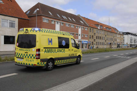finanse: Copenhagen Denmark - 14 June 2017. Medical ambulance  transport free sick and ill people  to the hospitals . Editorial
