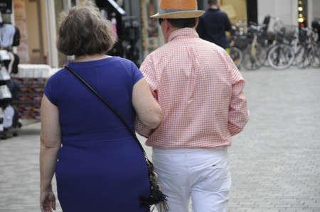 Copenhagen Denmark - 15.June 2017. Eldlery couples walk holding  hand in hand and walk in arms  on kobmagergade . Editorial