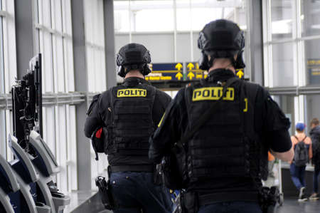 finanse: kastrupCopenhagen Denmark - 16 jULY   2017.   Danish  with wapenat Kastrup Interntional Aiport, and metro and train traffic was stop due to police order.