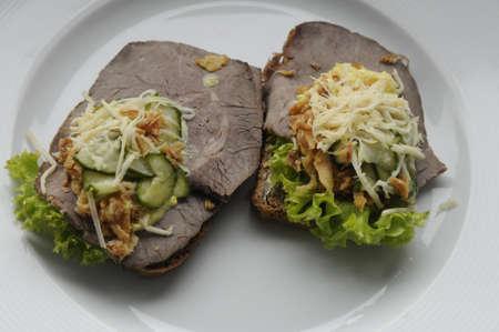 editorial: kastrupCopenhagen Denmark - 05 September . 2017.Danish smorbrod or open sandwich roast beef and pork and pickel and rubrod dark bread.