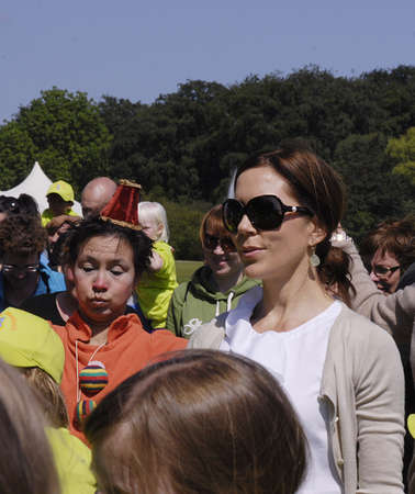arrives: KØBENHAVNCOPENHAGENDANMARK DENMARK.  H.R.H. Crown ary Fond and danish save the children arranged event children run and mary giving medals to runners at event, mary arrives and  was welcome by save the children general secretary  Mimi  Stilling Jokobse