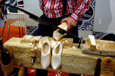 Ducth man making Dutch tradional wooden shoes In G�teborg  Sweden March 23,2006