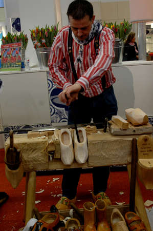 Ducth man making Dutch tradional wooden shoes In Gôteborg  Sweden March 23,2006 Editorial
