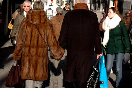 Weathy females and elderly couple  holding hand and hand and  mink fur Coat Copenhagen Denmark March 24,2006 Editorial