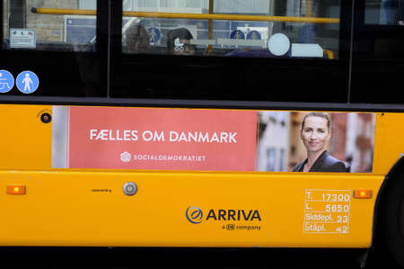 Copenhagen Denmark - 28.September. 2017.   Ms. Mette Frederiksen chairwoman of danish social democrat and prime minister from social democrat  post billboard posted on danish public bus system in danish capital Copenhagen. Редакционное