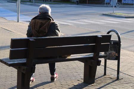 KastrupCopenhagen Denmark -30..October  2017.  Senior female waits for public bus. Editorial