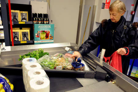 Copenhagen Denmark -02. November  2017.    Costumers  pay at casher at Coop chain fakta grocery store.