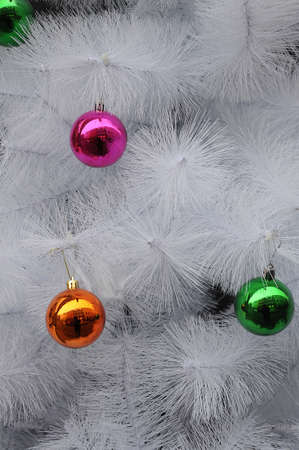 Articial christmas tree decoated with colourful ornaments . Stock Photo