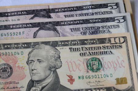 USA Dollar bills in five and ten. Stock Photo