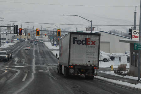 LEWISTON/IDAHO/USA 28.December  2017.   Fedex deliverly ruck on move to deliver goods to consumers .