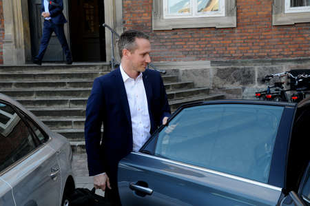 CopenhagenDenmark 06 April 2018_ Kristian Jensen danish minister for finance carry his own bags Copenhagen Denmark.