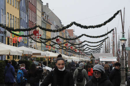 CopenhagenDenmark 09.November 2018 Christmas sweaosn on Nyhvn canal and . Christmas bazar and christmas hearts and light decoration on Nyhavn canal in Copenhagen Denmrk.