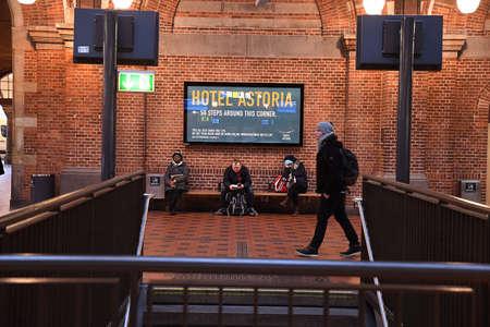 CopenhagenDenmark. 17..December 2018. .Travelers wating for may next trai at Copenahgen Main train station  in Copenhagen Denmark