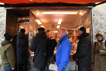 CopenhagenDenmark. 23.December 2018. .Christmas meat and beaf shoppers waiting out stand in line to buy stof for christmas eve dinner in PE lasrsen on Amagerbrodage in Copenhagen Denmark. Editorial