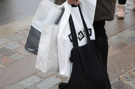 CopenhagenDenmark. 29.December 2018._Shooper with shoping bags with new or old christmas present for exchange  and after christms sale and before new years sale in varioys stores in danish capital. Editorial