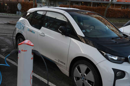 CopenhagenDenmark. 19.January 2019._ American electric tesla car German BMW electric auto an French  ranulat  car  at charge point in Copenhagen-