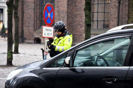 Copenhagen/Denmark. 22.January 2019._  Parking inspector tring to write parking fine ticket in danish captial Copenhagen .