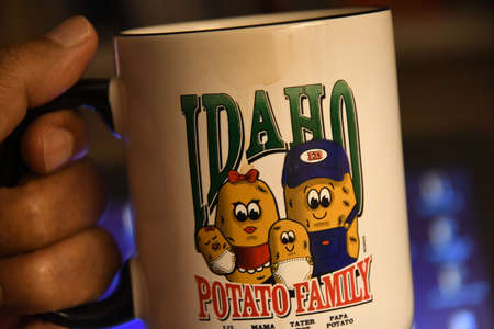 CopenhagenDenmark. 23.January 2019._Idaho potato family used as coffee mug or pen holder mug on table .
