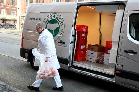 CopenhagenDenmark. 23.January 2019._  Butcher unload meet from meet van and delivers to butch shop in danish capital .