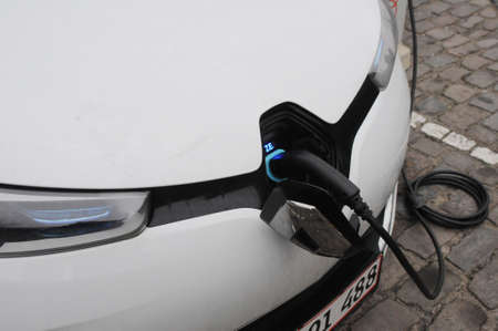 CopenhagenDenmark. 31January 2019._ German   BMW and French Renault electric cars at charge point in Copenhagen .