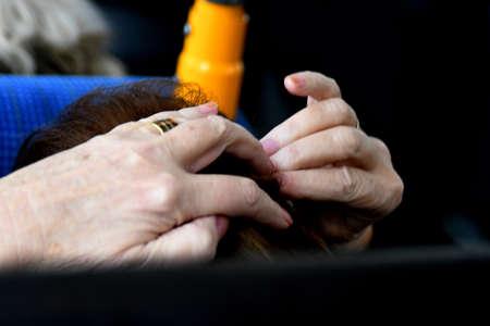 Copenhagen/Denmark. 01 Febuary 2019._ Senior female hands  using tir her hair during her bus journey in Copenhagen Denmark. Archivio Fotografico - 116581956