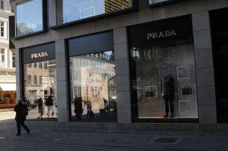 CopenhagenDenmark. 28.FEBUARY 2019._shoppers walks by Prada stpr on stroeget and obmagergade in danish capital.