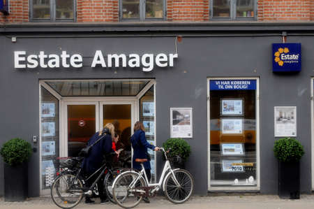 Copenhagen Denmark. 24.March 2019Females watch commercial in  real estate office on amagerbrogade in danis capital .