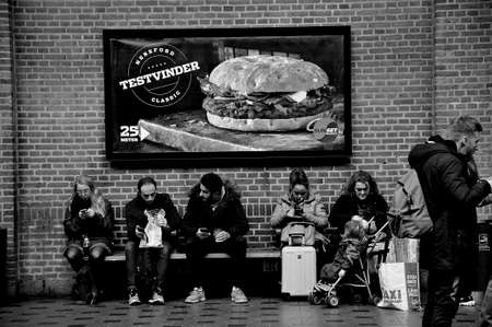 Copenhagen Denmark 23..February 2020  Travel life at Coopenahgen central train sation  passengers waiting for next trainand waitin for other purpose  and also traisn station has fast food chain MCdonald  . 新聞圖片