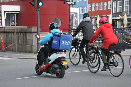 Copenhagen,Denmark , 04 May 2020.  Wolt deliveru persons in action in danish capital and seem like business is goidn well during covie-19 crisis in Denmark.